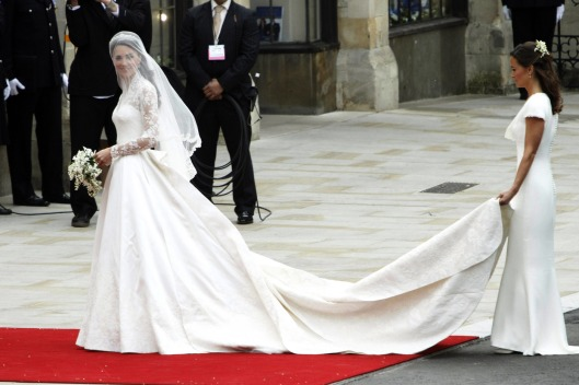 Kate Middleton reveals her McQueen gown as she arrives with sister Pippa at Westminster Abbey for the Royal Wedding